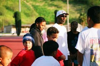 Angela Williams with youth members of the Southern California Cheetahs